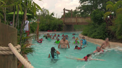 Vacationers Enjoying Lazy River at Water Park Stock Footage