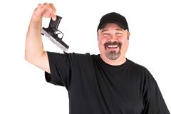 Man surrender holds his gun up properly Stock Photos