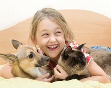 Girl with a dog and a cat Stock Photos