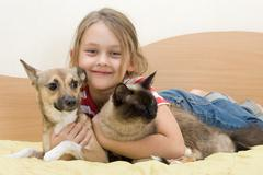 Girl with pets Stock Photos