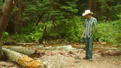 Gold prospecting metal detector river Stock Footage