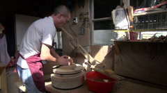 Uzbek artist creates beautiful pottery in small workshop in Central Asia Stock Footage