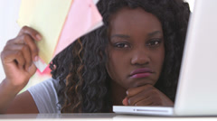 Unhappy black woman with bills - stock footage