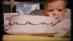 Twin boys in highchairs with birthday cakes, 434 vintage film home movie Stock Footage