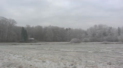 Grey winter landscape with frost in countryside + pan Stock Footage