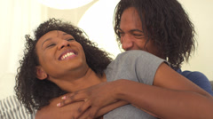 Black man hugging his girlfriend - stock footage