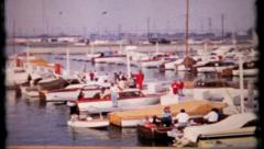 Boats are docked at Alamitos bay on California coast, 19 vintage film home movie Stock Footage