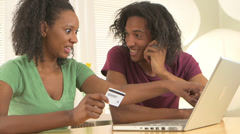 African couple making vacation reservations Stock Footage