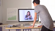 Stock Video Footage of Two Chinese women engaging in video conference