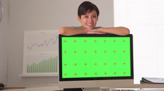 Chinese businesswoman standing by green screen computer - stock footage