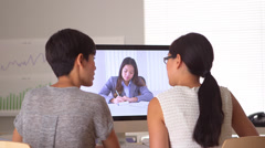 Chinese businesswomen having a web conference meeting - stock footage