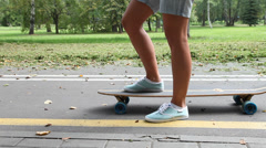 Unrecognizable girl skating on a longboard outdoors Stock Footage