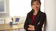 Happy Chinese businesswoman standing Stock Footage