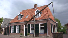 Ootmarsum: Traditional well with swape in Dutch village + pan brick house Stock Footage