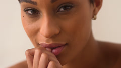 Close up of African American woman biting finger and playing with lips - stock footage