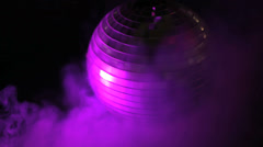 Disco ball in smoky purple light Stock Footage