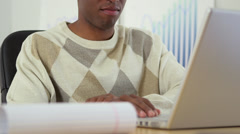 Black business man working at laptop computer - stock footage
