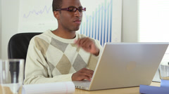 African American businessman working at laptop computer - stock footage