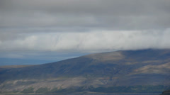 Wide time-lapse of clouds over hills and mountains in Iceland Stock Footage
