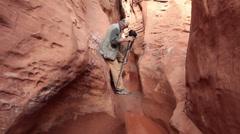 Photographer climbing through water desert slot canyon HD 1571 Stock Footage