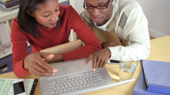 African American colleagues using laptop computer - stock footage