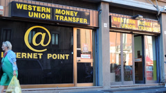 Stock Video Footage of Western union money transfer, window, Sicily.