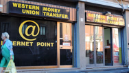 Western union money transfer, window, Sicily. Stock Footage