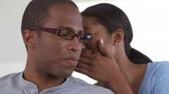 African American business woman whispering to co worker Stock Footage