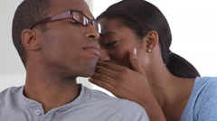 African American office worker whispering to colleague Stock Footage