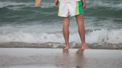 Swimmer man wetting and conditioning feet in ocean. Stock Footage