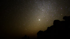 Stock Video Footage of Astrophotography Time Lapse -Night to Day in Desert- Pan