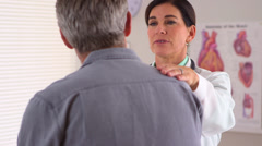 Doctor giving patient positive encouragement - stock footage