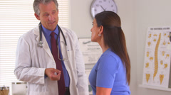 Doctor advising female patient Stock Footage