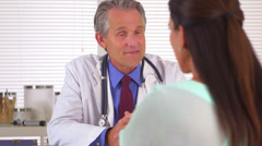 Patient talking to doctor in his office Stock Footage