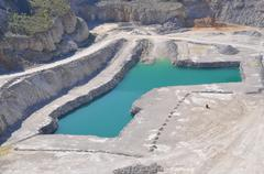 Quarry stone mining with the lake Stock Photos