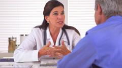 Doctor prescribing medication to elderly patient Stock Footage