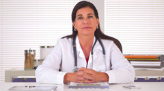 Sincere doctor looking at camera and giving positive encouragement - stock footage
