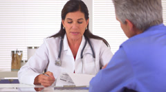Doctor reviewing medical history with patient Stock Footage