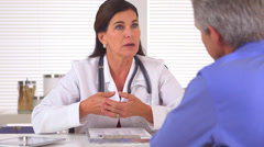 Doctor advising male patient on how to have a healthier lifestyle Stock Footage
