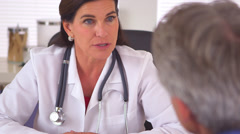 Sincere woman doctor advising elderly patient on future steps to recovery Stock Footage