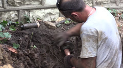 Plumber in hole cutting Stock Footage