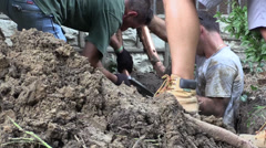 Plumbers in a ditch Stock Footage