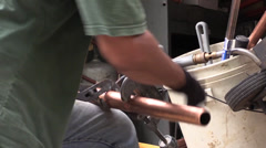Plumer cutting copper pipe Stock Footage