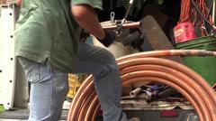 Plumber cutting water pipe Stock Footage