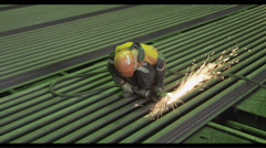Welder on the metallurgy plant  Stock Footage