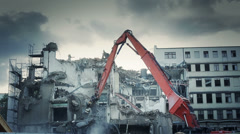 Demolishing a highrise building Stock Footage