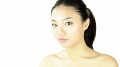 Attractive asian woman on white - stock footage