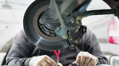 Mechanic changes brake pads Stock Footage