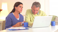 Stock Video Footage of Senior couple paying bills online