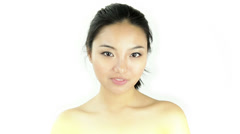 Attractive asian woman on white Stock Footage